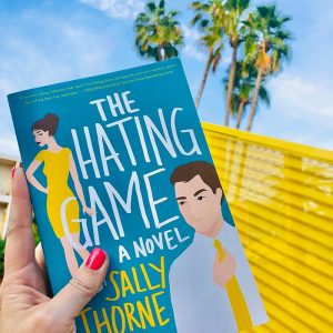 The Hating Game Book Cover in front of a palm tree