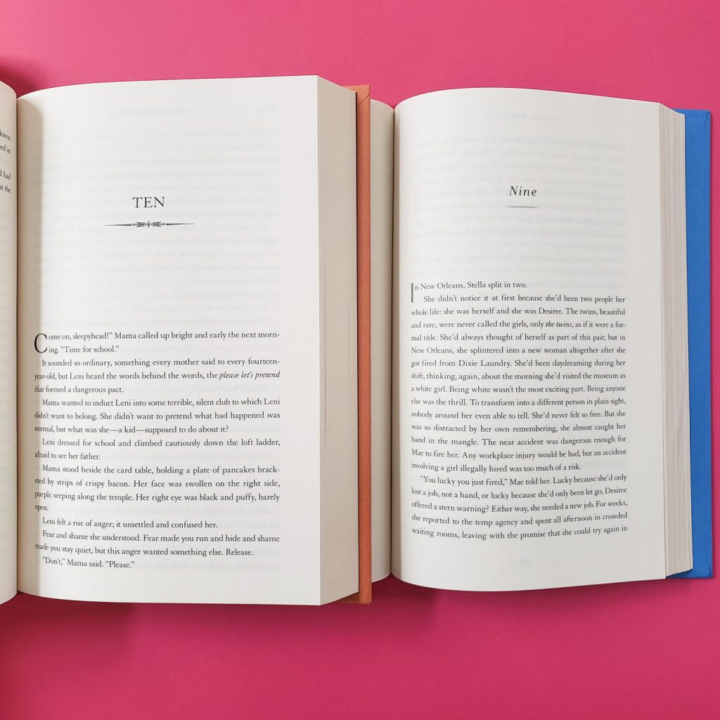 Two open books on pink background