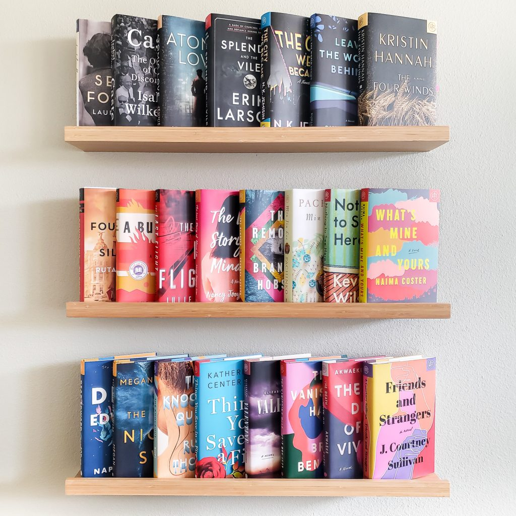3 rows of books on ledge shelving
