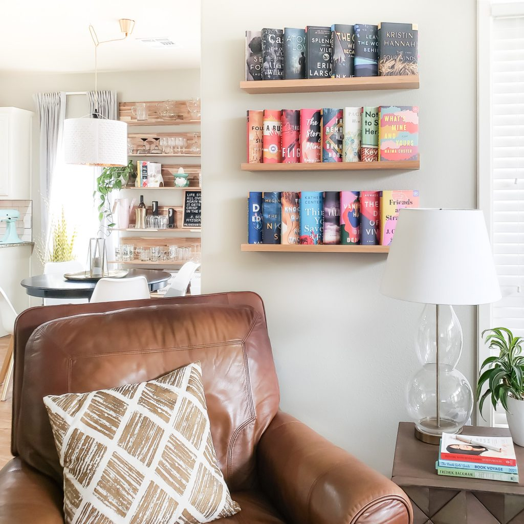 Books on wall behind leather chair