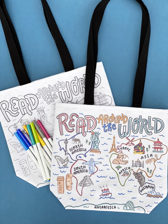 two world map library tote bags with markers for coloring